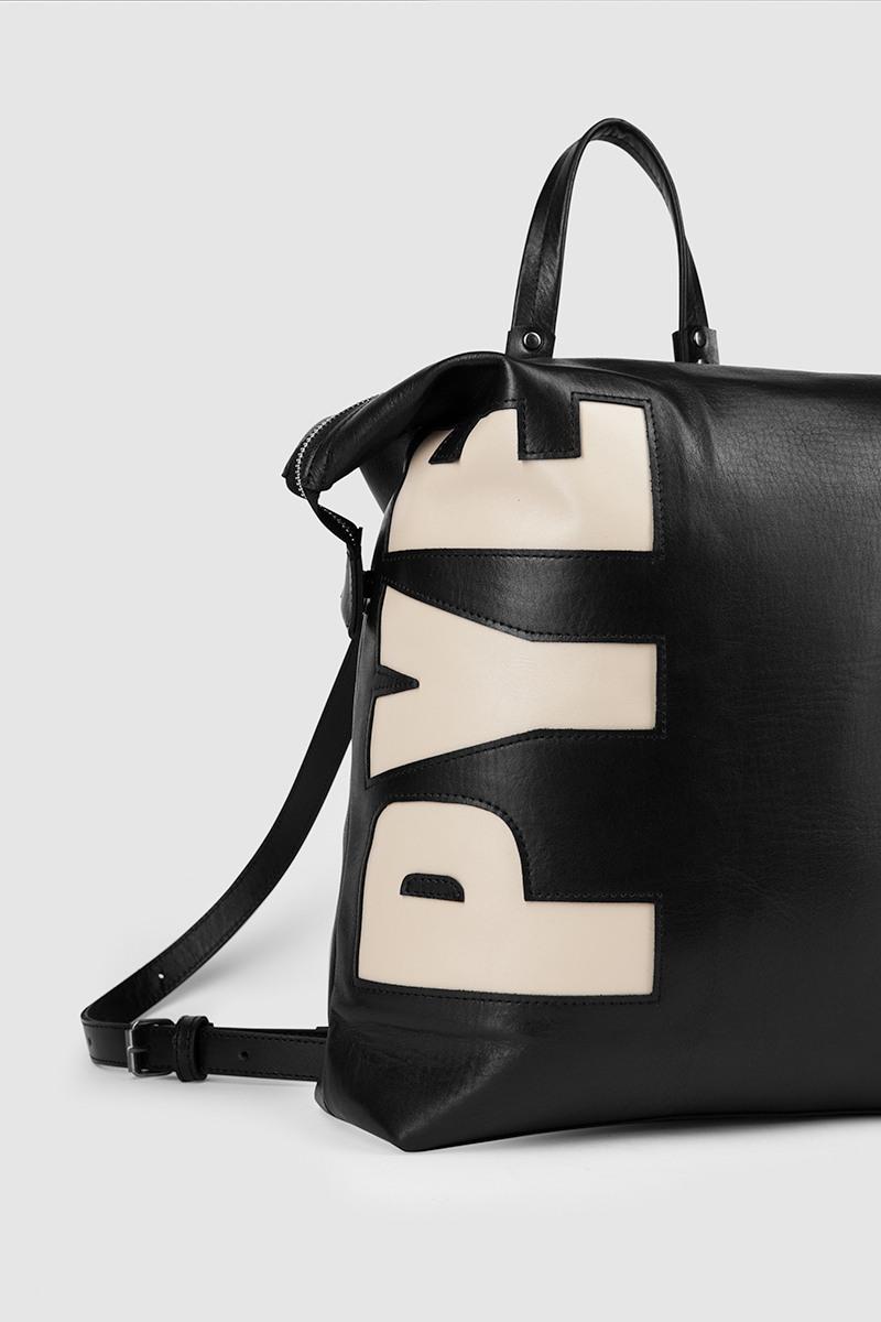 Рюкзак Personality &lt;br /&gt; 2-3 символаРюкзак-трансформер на 2-3 символа из новой лимитированной серии Personality&#13;<br>&#13;<br>Смысл линии Personality' в том, что каждый может выбрать инициалы и получить изделие с выбранной аббревиатурой.&#13;<br>&#13;<br>&#13;<br>вместительная сумка-рюкзак прямоугольной формы&#13;<br>&#13;<br>если перестегнуть лямки и загнуть крышку, он превращается в сумку через плечо&#13;<br>&#13;<br>унисекс&#13;<br>&#13;<br>держит форму&#13;<br>&#13;<br>большое основное отделение&#13;<br>&#13;<br>на задней и передней стенке рюкзака карманы на молнии&#13;<br>&#13;<br>внутренний карман для документов&#13;<br>&#13;<br>лямки на регуляторах из ремневой кожи&#13;<br>&#13;<br>защита нижних кантов от износа двойным дном&#13;<br>&#13;<br>тканная подкладка&#13;<br>&#13;<br>размеры: 32х36х10 см, идеально поместится MacBook 13&#13;<br>&#13;<br>&#13;<br>Срок изготовления рюкзака 7-14 дней&#13;<br>&#13;<br>Внимание! Изготовление изделии из линии Personality оформляется только при полной предоплате. &#13;<br>&#13;<br>В текст, размещенный на рюкзаке, помещается не более 2-3 символов, буквы размещаются только сбоку.&#13;<br>При заказе вам необходимо:&#13;<br>1. Совершить заказ, нажать кнопку купить.&#13;<br>2. В комментарии к заказу вбить набор заглавных латинских букв или цифр.&#13;<br>3. И ожидать звонка, наш радист обязательно свяжется с вами для уточнения деталей.&#13;<br>&#13;<br>Вещи, сделанные по индивидуальным меркам, подлежат возврату/обмену только в случае брака либо ошибочно высланного изделия. В соответствии со ст.484 и ст. 487 Гражданского кодекса РФ Покупатель обязуется принять заказанный товар и оплатить его полную стоимость. Покупатель уведомлен, что в соответствии с Законом РФ О защите прав потребителей товар надлежащего качества, оформленный под заказ и по индивидуальным требованиям клиента, обмену и возврату не подлежит.<br><br>Цвет: Черный