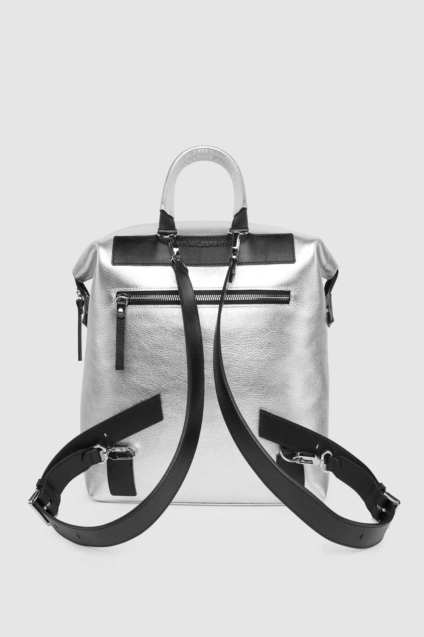 РюкзакРюкзак-трансформер &#13;<br>&#13;<br>&#13;<br>яркая вместительная сумка-рюкзак прямоугольной формы, выполнена из металлизированной кожи&#13;<br>&#13;<br>если перестегнуть лямки и загнуть крышку, он превращается в сумку через плечо&#13;<br>&#13;<br>унисекс&#13;<br>&#13;<br>держит форму&#13;<br>&#13;<br>большое основное отделение&#13;<br>&#13;<br>на задней и передней стенке рюкзака карманы на молнии&#13;<br>&#13;<br>внутренний карман для документов&#13;<br>&#13;<br>лямки на регуляторах из ремневой кожи&#13;<br>&#13;<br>защита нижних кантов от износа двойным дном&#13;<br>&#13;<br>тканная подкладка&#13;<br>&#13;<br>размеры: 32х36х10 см, идеально поместится MacBook 13<br><br>Цвет: Серебро
